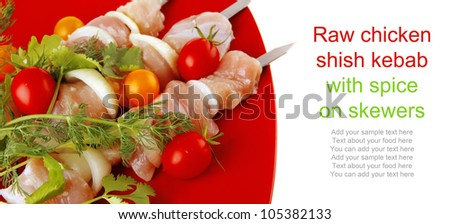 raw chicken kebabs served with on red plate