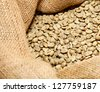 raw coffee beans in a sack - stock photo