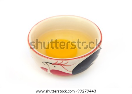 Raw egg in chicken bowl in the white background