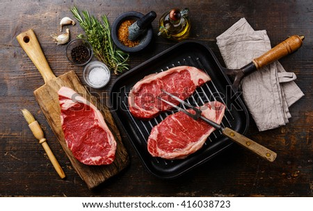 Raw fresh meat Steak Striploin with ingredients and frying Grill pan