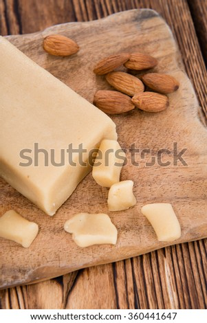 Raw Marzipan (close-up shot) on vintage wooden background
