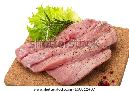 Raw pork steak isolated with rosemary