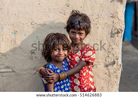 RAXAUL, INDIA - NOV 12: Unidentified Indian children on Nov 12, 2013 in Raxaul, Bihar state, India. Bihar is one of the poorest states in India. The per capita income is about 300 dollars.