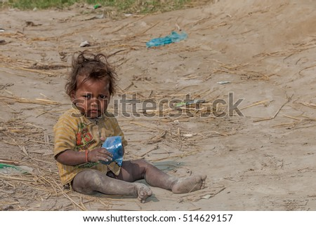 RAXAUL, INDIA - NOV 14: Unidentified Indian girl on Nov 14, 2013 in Raxaul, Bihar state, India. Bihar is one of the poorest states in India. The per capita income is about 300 dollars.