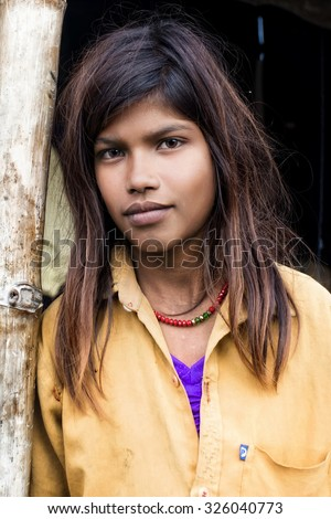 RAXAUL, INDIA - NOV 7: Unidentified Indian girl on Nov t, 2013 in Raxaul, Bihar state, India. Bihar is one of the poorest states in India. The per capita income is about 300 dollars.