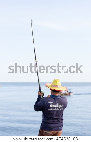 RAYONG, THAILAND - December 12, 2015: Man use Fishing Pole for fishing at near sea