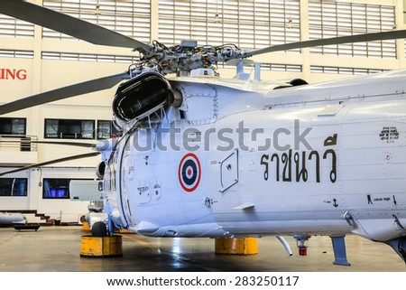 RAYONG , THAILAND- MAY 16, 2015: Sikorsky UH-60 Black Hawk helicopter No.3208 of royal thai navy standby in the hangar for maintenance. U-TAPAO Airport, Rayong
