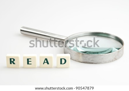 Read word and magnifying glass