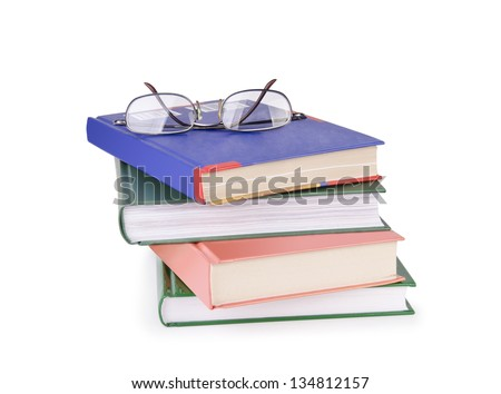 Reading glasses with books isolated on the white background.