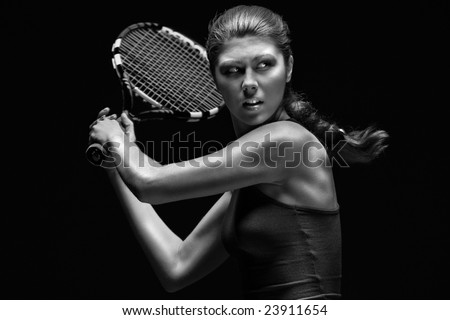 Ready to hit! Female tennis player with racket ready to hit a tennis ball.