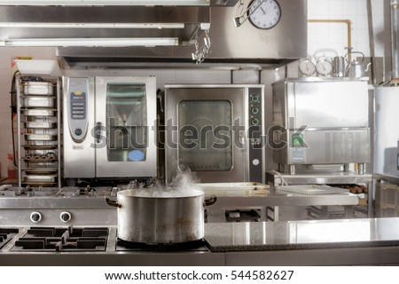 Real industrial kitchen pots in a professional restaurant kitchen
