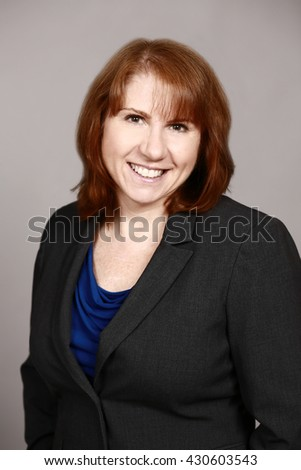 real woman executive on gray background
