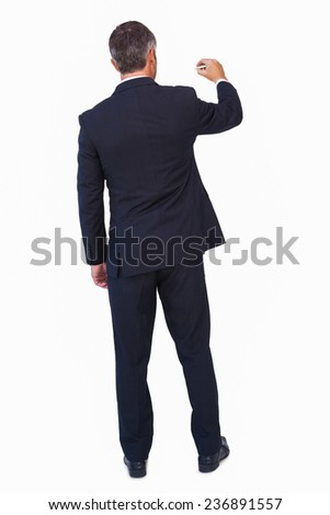 Rear view of a businessman drawing with a chalk on white background