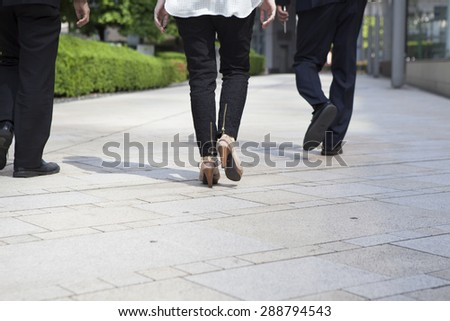 Rear view of businessman walking in office
