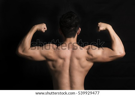 Rear view of healthy muscular young man with his arms, Back muscle