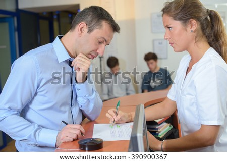 Receptionist explaining to client