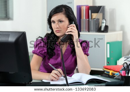 Receptionist making appointment