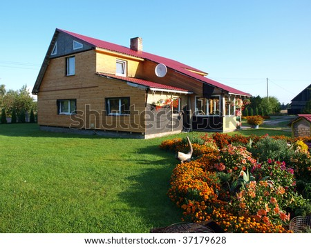 Reconstructed modern style country house and flower garden