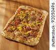 rectangular gourmet pizza with sausage and colorful peppers - stock photo