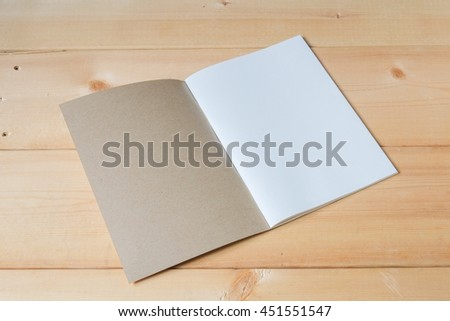 recycle notebook on wood background