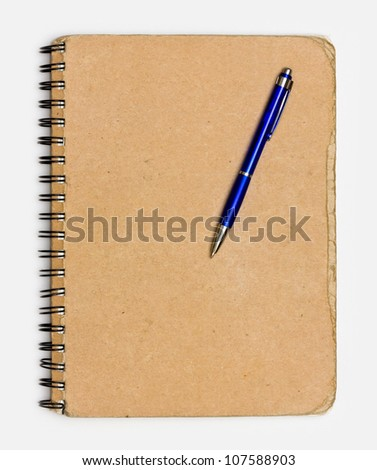 recycled paper notebook front cover with a pen