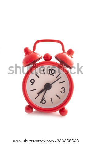 Red Alarm Clock close up isolated on a white background