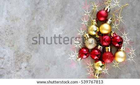 red and gold balls sort shape look like Christmas Tree on gray abstract concrete background