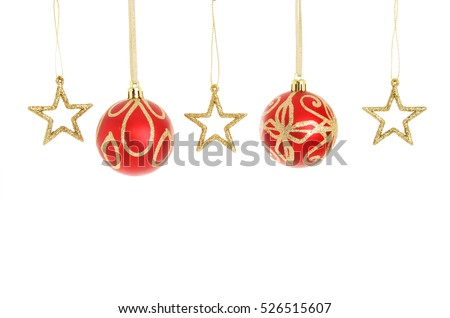 Red and gold glitter Christmas baubles and stars hanging in a line isolated against white