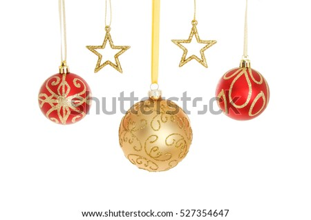 Red and gold glitter Christmas baubles and stars isolated against white