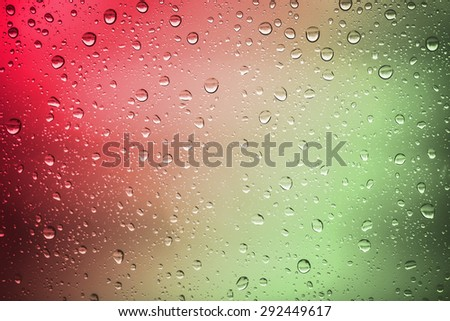 red and green water drops on background