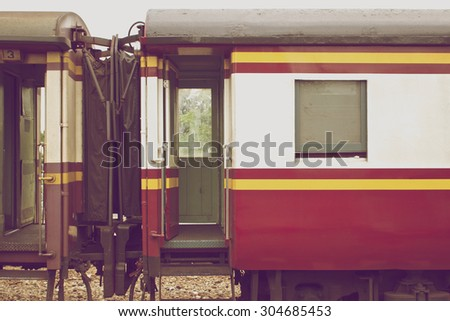 Red and white bogie of train connect together in vintage style.