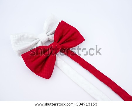 Red and white bow tie on white background