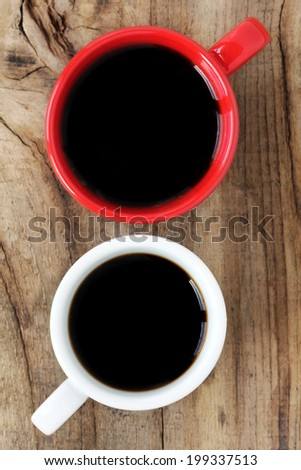Red and white cups of black espresso coffee