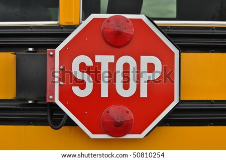Red and White School Bus Stop Sign which could be used as stop drugs violence or Bullies