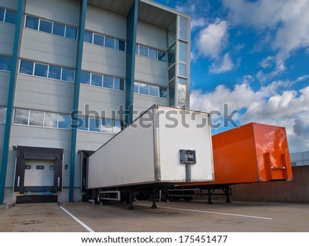 Red and White Trailer in Front of Docking Bay ready for Transport