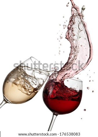 Red and white wine being spilled from two glasses.