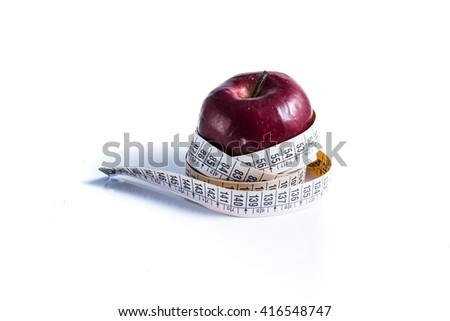 red apple measured the meter on a white background. Health and diet
