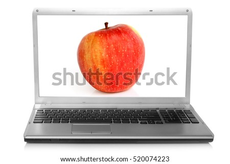 Red apple on notebook screen on a white background