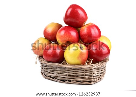 red apples in the basket with sawdust