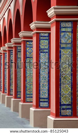 Red Arch Columns Pathway with Classic Colorful tiles - Lima Peru