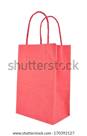 Red bag against a white background with soft shadows. Copy space.