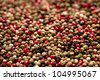 Red, black, green and white peppercorns, shallow dof - stock