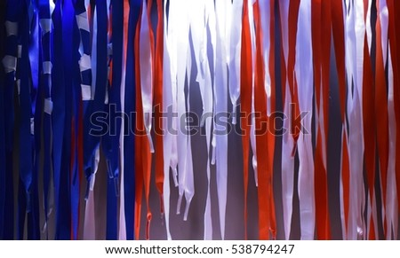 Red ,blue and white curtain and round stage
