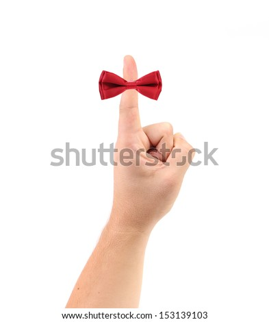 Red bow on finger.