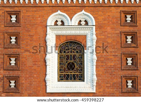 Red brick old church wall with a window