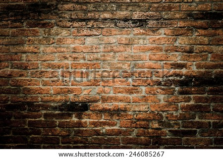 red brick wall texture grunge background with vignetted corners