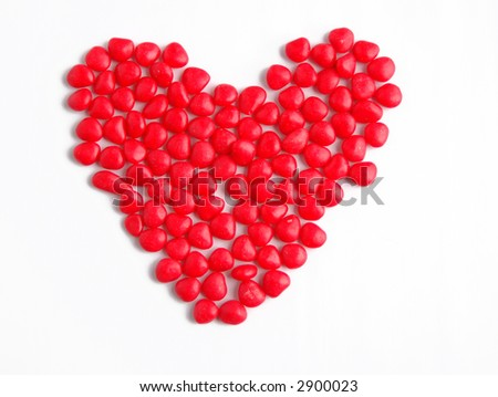 red candies arranged in heart shape