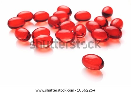 Red capsules on white background