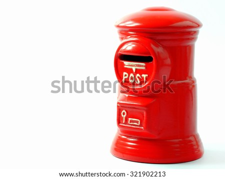Red ceramic postbox on white background