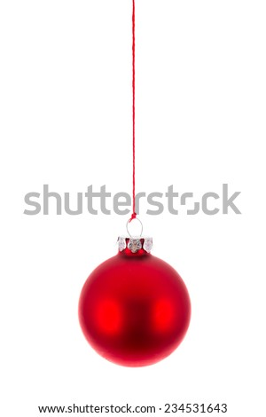 Red Christmas ball hanging at a red rope over white